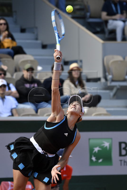 Garbine Muguruza of Spain plays Taylor Townsend of the USA during their women?s first round match during the French Open tennis tournament at Roland Garros in Paris, France, 26 May 2019.  EPA-EFE/JULIEN DE ROSA