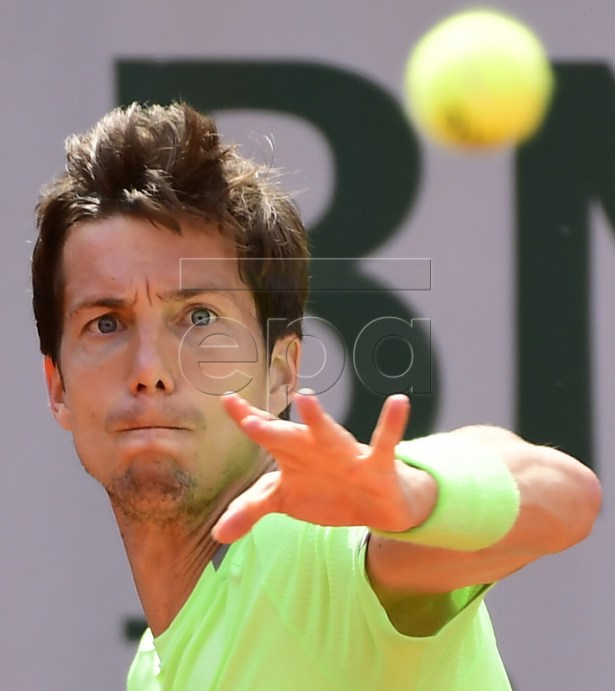 Aljaz Bedene of Britain plays Borna Coric of Croatia during their men?s first round match during the French Open tennis tournament at Roland Garros in Paris, France, 27 May 2019.  EPA-EFE/CAROLINE BLUMBERG
