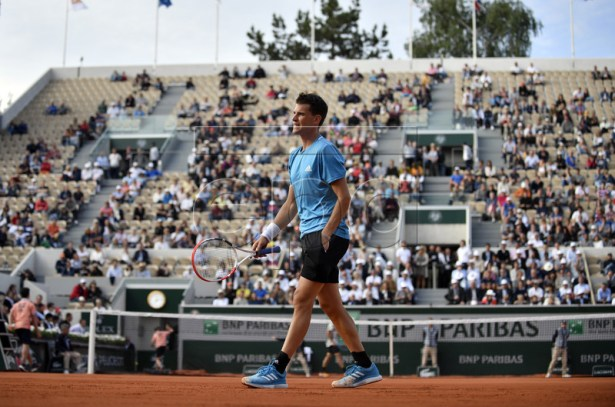 Dominic Thiem of Austria plays Tommy Paul of the USA during their men?s first round match during the French Open tennis tournament at Roland Garros in Paris, France, 27 May 2019. EPA-EFE/JULIEN DE ROSA