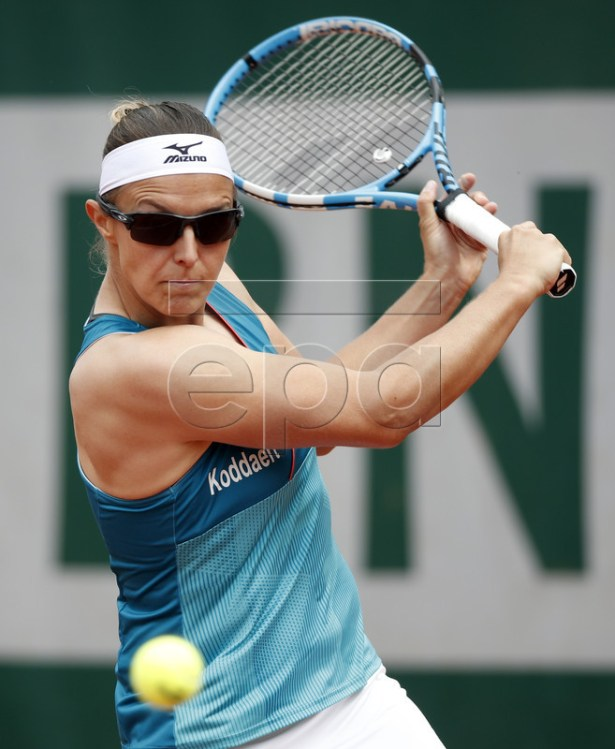 Kirsten Flipkens of Belgium plays Monica Puig of Puerto Rico during their women?s first round match during the French Open tennis tournament at Roland Garros in Paris, France, 28 May 2019.  EPA-EFE/YOAN VALAT