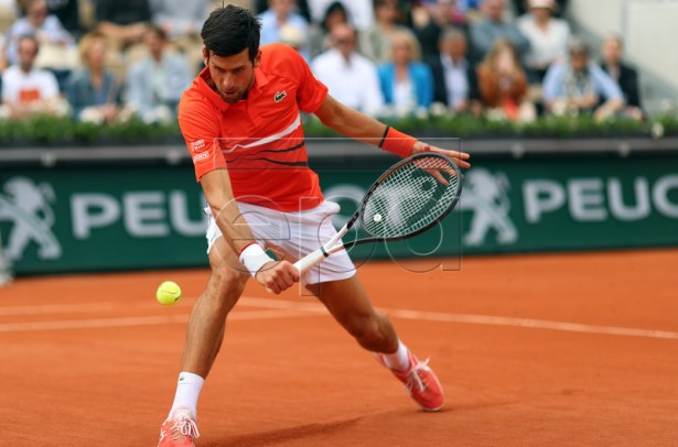 Novak Djokovic of Serbia plays Henri Laaksonen of Switzerland during their men?s second round match during the French Open tennis tournament at Roland Garros in Paris, France, 30 May 2019. EPA-EFE/SRDJAN SUKI