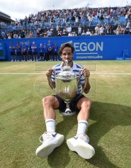 Feliciano Lopez of Spain poses with the trophy after winning his final match against Marin Cilic of Croatia during the Aegon Championships tennis tournament at the Queens Club in London, Britain, 25 June 2017.  EPA/FACUNDO ARRIZABALAGA
