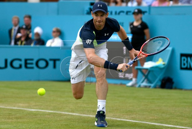 Britain's Andy Murray of Britain in action against Nick Kyrgios of Australia  during their  first round match at the Fever Tree Championships at Queen's Club in London, Britain, 19 June 2018.  EPA-EFE/NEIL HALL