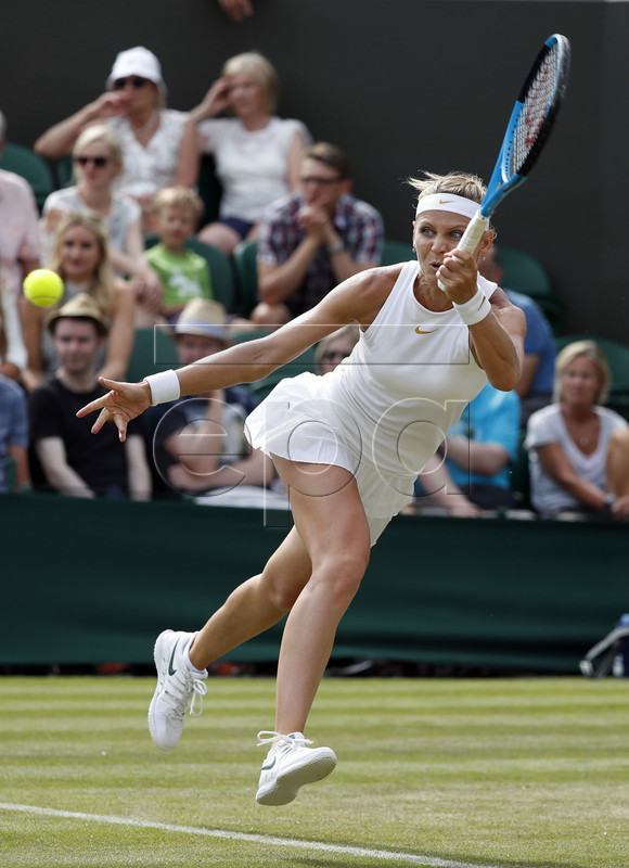 Lucie Safarova of the Czech Republic returns to Agnieszka Radwanska of Poland in their second round match during the Wimbledon Championships at the All England Lawn Tennis Club, in London, Britain, 04 July 2018. EPA-EFE/NIC BOTHMA EDITORIAL USE ONLY/NO COMMERCIAL SALES