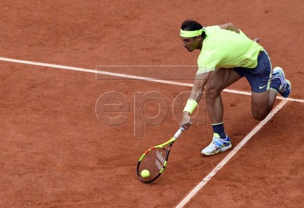 Rafael Nadal of Spain plays Dominic Thiem of Austria during their men?s final match during the French Open tennis tournament at Roland Garros in Paris, France, 09 June 2019. EPA-EFE/CAROLINE BLUMBERG