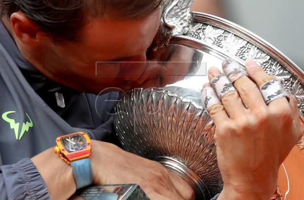 Rafael Nadal of Spain kisses the trophy after winning the men?s final match against Dominic Thiem of Austria during the French Open tennis tournament at Roland Garros in Paris, France, 09 June 2019. Nadal won the French Open title 12th times. EPA-EFE/SRDJAN SUKI