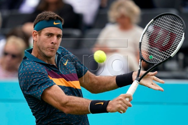 Argentina's Juan Martin del Potro serves to Canada's Denis Shapovalov during their round 32 match at the Fever Tree Championship at Queen's Club in London, Britain, 19 June 2019. The tournament runs from 17th June till 23 June 2019. EPA-EFE/WILL OLIVER