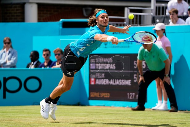 Greece's Stefanos Tsitsipas in action against Canada's Felix Auger Aliassime during their quarter final match at the Fever Tree Championship at Queen's Club in London, Britain, 21 June 2019. EPA-EFE/WILL OLIVER