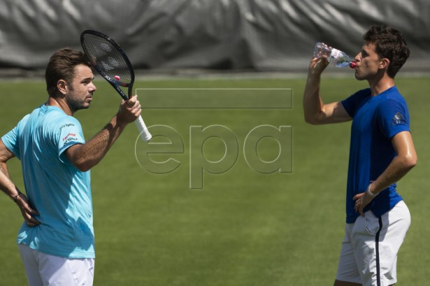 Stan Wawrinka of Switzerland, left, and Dominic Thiem of Austria take a break during a training session at the All England Lawn Tennis Championships in Wimbledon, London, on Thursday, June 27, 2019. EPA-EFE/PETER KLAUNZER EDITORIAL USE ONLY; NO SALES, NO ARCHIVES