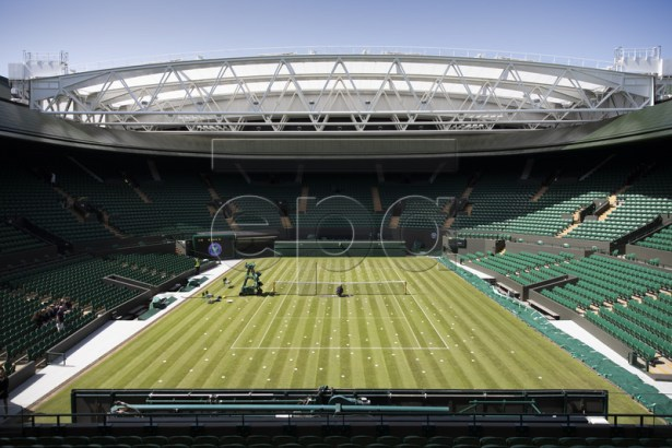 View of the number 1 court with the new roof construction, at the All England Lawn Tennis Championships in Wimbledon, London, on Thursday, June 27, 2019. The Wimbledon Tennis Championships 2019 will be held in London from 1 July to 14 July. EPA-EFE/PETER KLAUNZER EDITORIAL USE ONLY; NO SALES, NO ARCHIVES