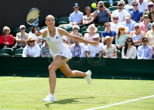 Karolina Pliskova of Czech Republic in action against Lin Zhu of China during their first round match at the Wimbledon Championships at the All England Lawn Tennis Club, in London, Britain, 01 July 2019. EPA-EFE/FACUNDO ARRIZABALAGA EDITORIAL USE ONLY/NO COMMERCIAL SALES