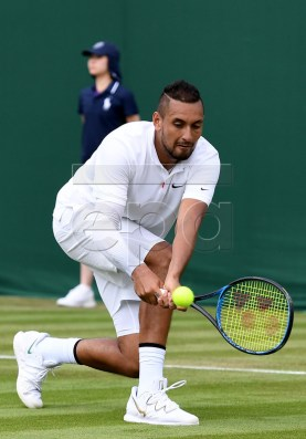 Nick Kyrgios of Australia in action against Jordan Thompson of Australia during their first round match at the Wimbledon Championships at the All England Lawn Tennis Club, in London, Britain, 02 July 2019. EPA-EFE/ANDY RAIN EDITORIAL USE ONLY/NO COMMERCIAL SALES