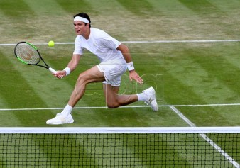 Milos Raonic of Canada in action against Robin Haase of the Netherlands during their second round match at the Wimbledon Championships at the All England Lawn Tennis Club, in London, Britain, 03 July 2019. EPA-EFE/FACUNDO ARRIZABALAGA EDITORIAL USE ONLY/NO COMMERCIAL SALES