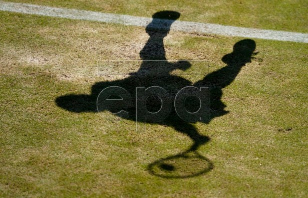 The shadow of Alison Van Uytvanck of Belgium in action against Ashleigh Barty of Australia during their second round match at the Wimbledon Championships at the All England Lawn Tennis Club, in London, Britain, 04 July 2019. EPA-EFE/NIC BOTHMA EDITORIAL USE ONLY/NO COMMERCIAL SALES