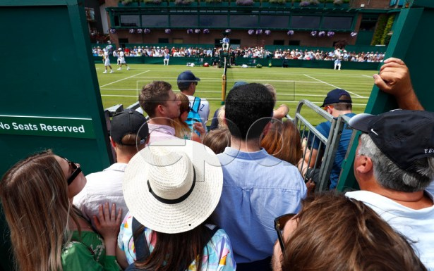 Spectators watch third round action at the Wimbledon Championships at the All England Lawn Tennis Club, in London, Britain, 05 July 2019. EPA-EFE/NIC BOTHMA EDITORIAL USE ONLY/NO COMMERCIAL SALES