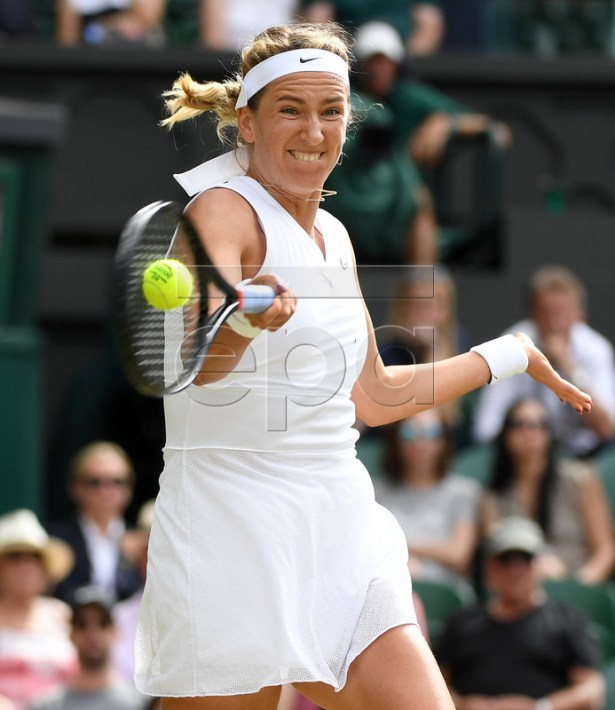 Victoria Azarenka of Belarus in action against Simona Halep of Romania during their third round match for the Wimbledon Championships at the All England Lawn Tennis Club, in London, Britain, 05 July 2019. EPA-EFE/ANDY RAIN EDITORIAL USE ONLY/NO COMMERCIAL SALES