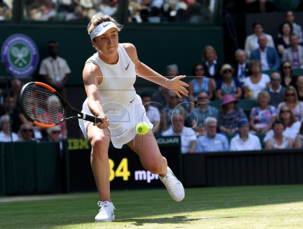 Elina Svitolina of Ukraine in action against Simona Halep of Romania during their semi final match for the Wimbledon Championships at the All England Lawn Tennis Club, in London, Britain, 11 July 2019. EPA-EFE/ANDY RAIN EDITORIAL USE ONLY/NO COMMERCIAL SALES
