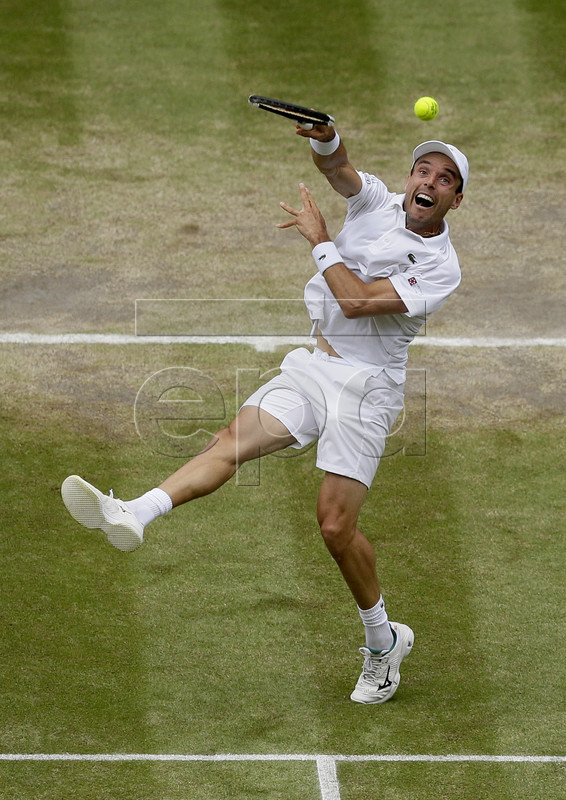 Roberto Bautista Agut of Spain in action against Novak Djokovic of Serbia during their semi final match for the Wimbledon Championships at the All England Lawn Tennis Club, in London, Britain, 12 July 2019. EPA-EFE/Tim Ireland / POOL EDITORIAL USE ONLY/NO COMMERCIAL SALES