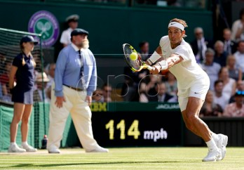 Rafael Nadal of Spain in action against Roger Federer of Switzerland during their semi final match for the Wimbledon Championships at the All England Lawn Tennis Club, in London, Britain, 12 July 2019. EPA-EFE/WILL OLIVER EDITORIAL USE ONLY/NO COMMERCIAL SALES