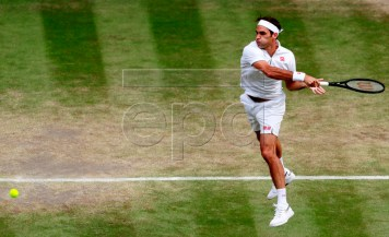 Roger Federer of Switzerland in action against Rafael Nadal of Spain during their semi final match for the Wimbledon Championships at the All England Lawn Tennis Club, in London, Britain, 12 July 2019. EPA-EFE/ANDREW COULDRIDGE / POOL EDITORIAL USE ONLY/NO COMMERCIAL SALES