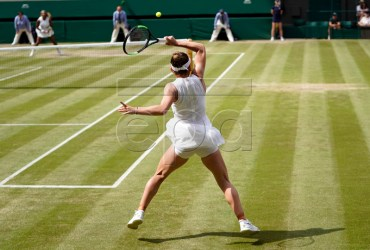 Simona Halep of Romania returns to Serena Williams of the US in the women's final of the Wimbledon Championships at the All England Lawn Tennis Club, in London, Britain, 13 July 2019. EPA-EFE/WILL OLIVER EDITORIAL USE ONLY/NO COMMERCIAL SALES