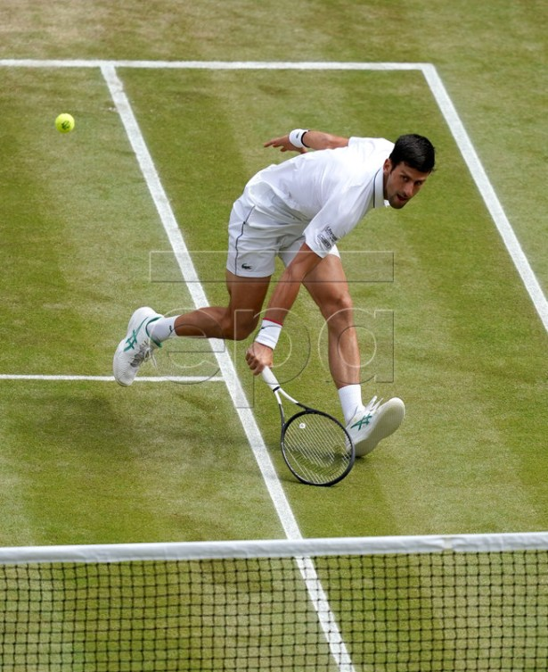 Novak Djokovic of Serbia in action against Roger Federer of Switzerland during their Men's final match for the Wimbledon Championships at the All England Lawn Tennis Club, in London, Britain, 14 July 2019. EPA-EFE/WILL OLIVER EDITORIAL USE ONLY/NO COMMERCIAL SALES