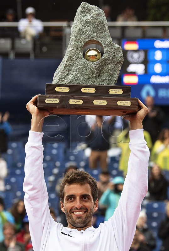 Albert Ramos-Vinolas of Spain lifts the trophy after defeating Cedrik-Marcel Stebe of Germany in their final match of the Swiss Open tennis tournament in Gstaad, Switzerland, 28 July 2019. EPA-EFE/PETER SCHNEIDER