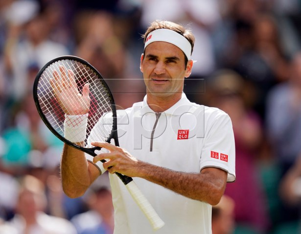 Roger Federer of Switzerland celebrates his win over Lloyd Harris of South Africa in their first round match during the Wimbledon Championships at the All England Lawn Tennis Club, in London, Britain, 02 July 2019. EPA-EFE/WILL OLIVER EDITORIAL USE ONLY/NO COMMERCIAL SALES