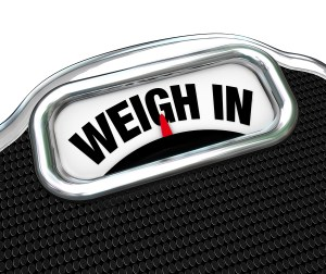 The words Weigh In on a scale representing the need to check you