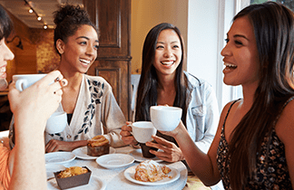 Skin care Ingredients Women of color over 50 having coffee
