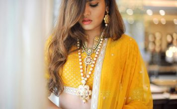 Beautiful Indian model dressed in a yellow wedding gown