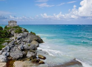 romantic honeymoon destinations -Tulum Mexico's beaches, clear waters, blue skies and mountains