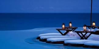 Activities that encourage attachment could be this romantic swimming pool complete with candlights and white towels dn 2009535-bigthumbnail