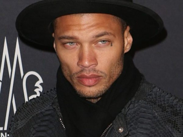 Jeremy Meeks with black hat and scarf thick designer sweater