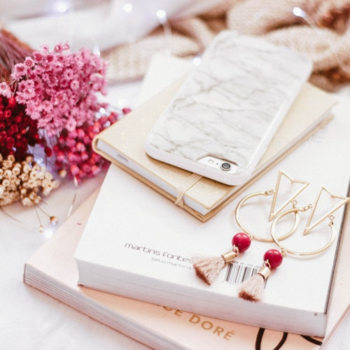 sterling sliver earrings, cell phone and books