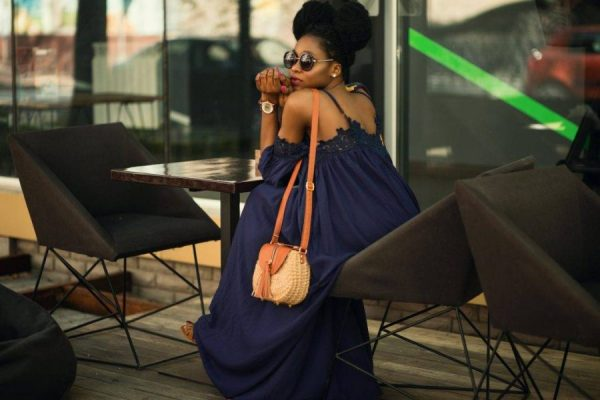 Why Women Choose to Be the Side Chick woman sitting alone outside an eatery