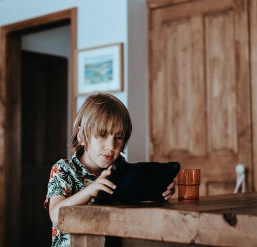 Ways to Motivate Kids to Learn, Play, and Love Life small child on tablet