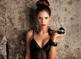 Know What Your Perfume Says About Your Personality lady holding bottle of perfume