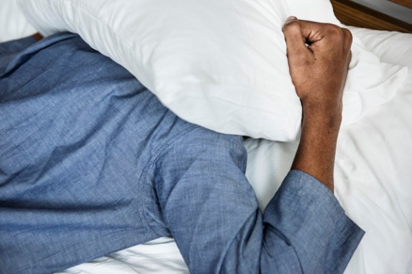 Depression: Is the Cure in Your Spiritually? A man with a pillow over his head