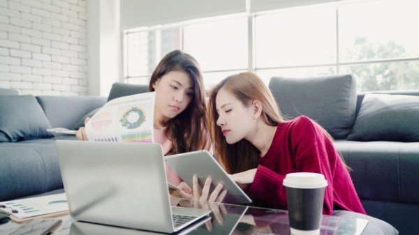 cheaters lesbian-asian-couple-using-laptop-making-budget-living-room-home-sweet-couple-enjoy-love-mome