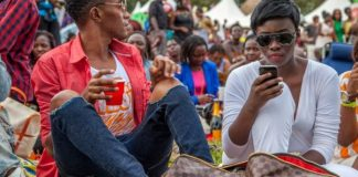 Slim Emcee (UG) the poet Truth_From_Africa_Photography couple at park man holding cup woman on phone