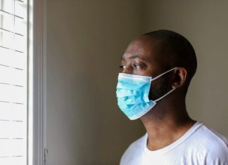 You and your partner could have coronavirus black man with mask