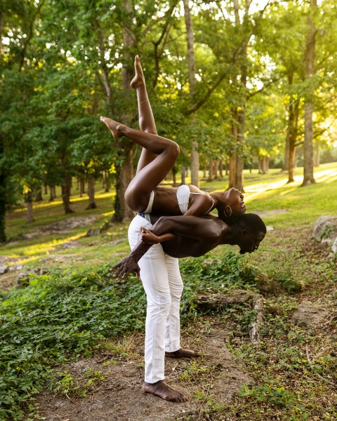 black love couple in park she is on his back to back