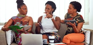 3 black women sitting on sofa with laptops photo by PICHA Stock