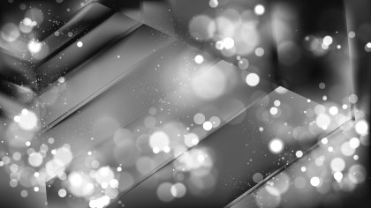 Abstract Black and Grey Bokeh Defocused Lights Background Design