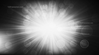Black and White Defocused Lights with Sun Rays Background