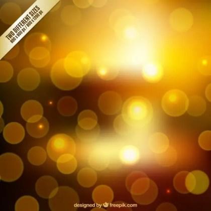 Blurred Background in Golden Tones Free Vector