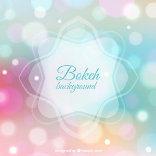 Bokeh Background in Pastel Colors Free Vector