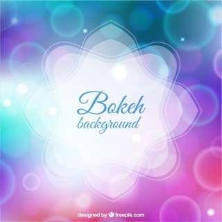 Bokeh Background in Purple and Blue Tones Free Vector