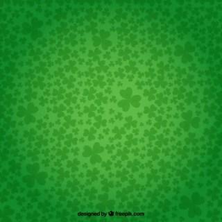 Shamrocks Background in Green Color Free Vector